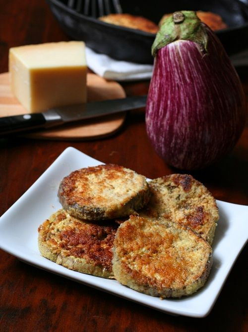 Dipped in a mixture of almond flour, garlic and parmesan, these fried eggplant slices are sure to please.
