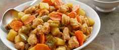 Enjoy this take out restaurant of fried pork, sliced carrots, green bell peppers and pineapple at home.