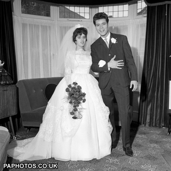 Singer Cliff Richard with his 18 year old sister Donella Webb as he was about to escort her from home in Colne Road, Winchmore Hill, London, for her wedding at Waltham Abbey. Miss Webb was being married to Paul Stevens in 1961.