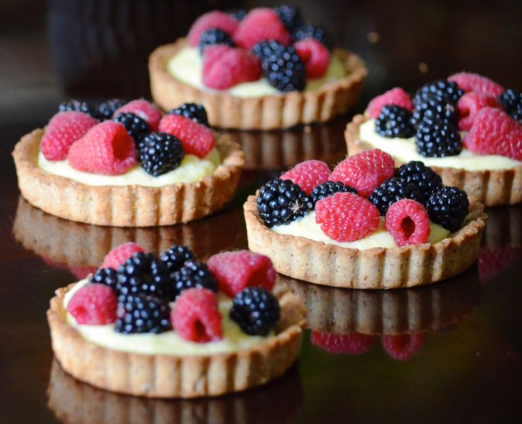 la madeleine's famous copycat recipe for the best almond tart shell filled with homemade pastry cream and fresh berries