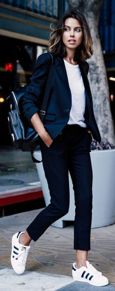 Annabelle Fleur suits up in this navy blazer and slacks combination.   Blazer/Trousers: The Kooples, Sneakers: Adidas.