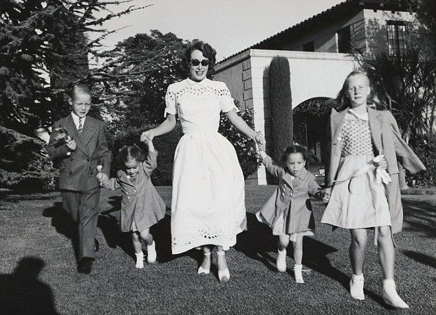 Joan Crawford with her children, Christina, Christopher, Cathy, and Cynthia