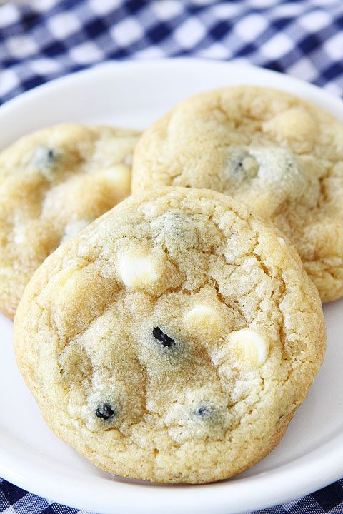 Lemon Blueberry Pudding Cookies on twopeasandtheirpod.com. Ingredients: sugar, lemon zest, butter, brown sugar, instant lemon pudding mix, eggs, vanilla, flour, baking soda, salt, dried blueberries, white chocolate chips