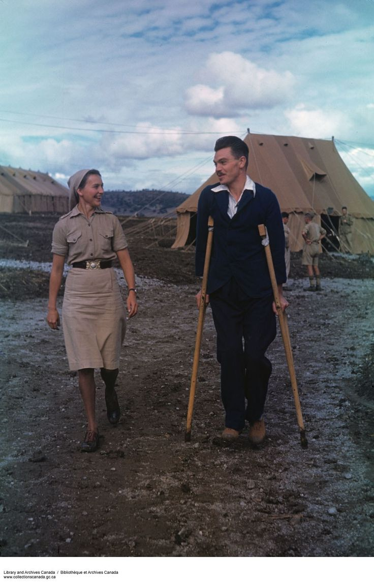 """""""Cpl. Bill Kay Strolls with Nursing Sister Dorothy Rapsey."""" [Source] The uniform for North Africa was the same color as soldiers' were and consisted of a beige short sleeved dress that ended just below the knee, a beige veil, black stockings and shoes. Their brown belt is the same as the one seen in the Bluebirds uniform. #ww2 #cdnhistory"""