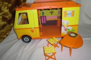Barbie van - grantmother had one like this leftover from my aunts that I used to play with. It had a big purple monster sticker on the top...