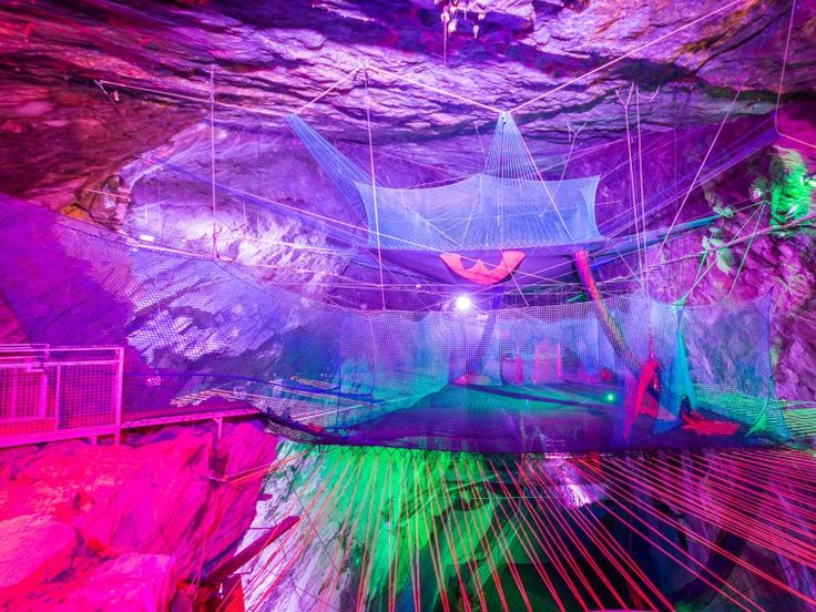 Bounce Below is a set of three giant trampolines nestled inside the Llechwedd Slate Caverns — a former Victorian slate mine in Blaenau Ffestiniog, North Wales. It was created by Zip World, a company specializing in adventure activities.