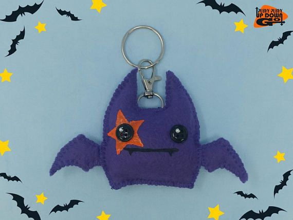Clip something adorable to your keys, backpack, or purse with a Kawaii Glam Rock Star Plush Bat Keychain & Bag Charm! Inspired by 70s Glam Rock, these cute purple bat charms make wonderful gifts, kawaii accessories, or a great treat for yourself and friends! Each charm keychain has a lanyard clasp and one key ring so it's ready to be clipped to your favorite bag or to help prevent you from losing your keys.