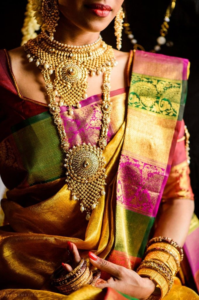 Unique yellow with multi color saree or sari with bridal jewellery.