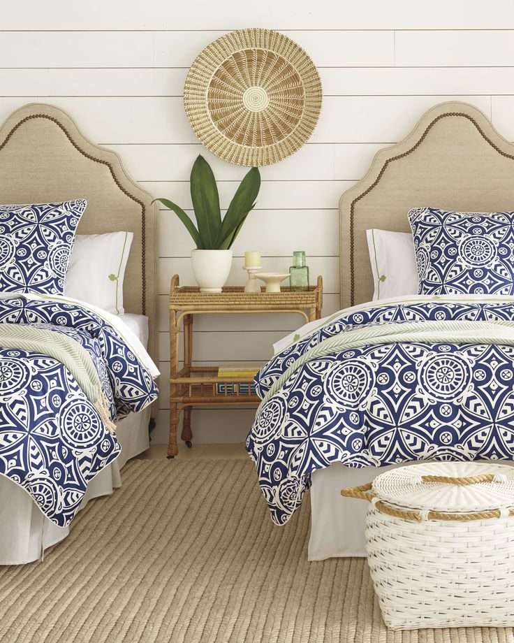 Beautiful coastal inspired bedroom with seagrass I wicker I blue comforters