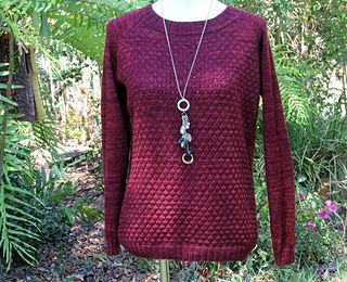 Beautiful, warm and lightweight sweater. Amazing deep red colour and interesting texture pattern on front and back. Raglan sleeve styling.