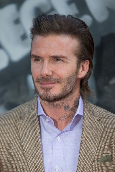 """David Beckham Photos Photos - Former England football captain David Beckham poses for a photograph upon arrival at the European Premiere of """"King Arthur: Legend of the Sword"""" in London on May 10, 2017.  / AFP PHOTO / Daniel LEAL-OLIVAS - The London Premiere of 'King Arthur: Legend of the Sword'"""