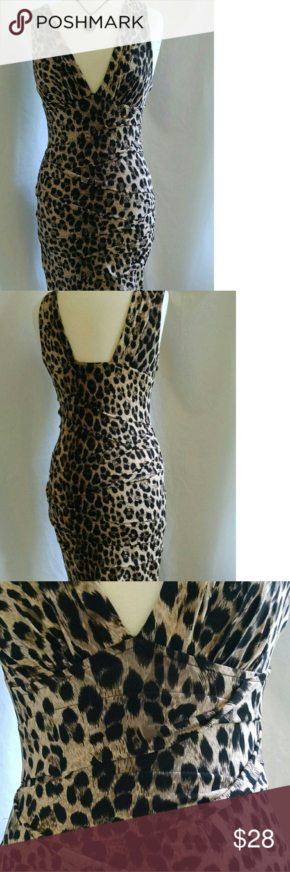 Forever 21 animal print bodycon dress M Sexy body hugging dress has plunge neckline and back. Poly spandex fabric has unique zigzag zag fold design that hides flaws and hold you in. This dress is very flattering. Above knee and runs small. Excellent condition. Clean and ready to wear. SIZE M, but go by these Measurements :bust fits 32-36, waist 28-30. More like a small Forever 21 Dresses Mini