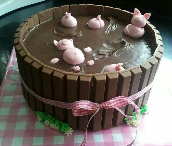 Cute pigs in the mud cake