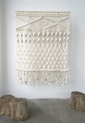 This would be beautiful in the front room. I should get back to knotting.