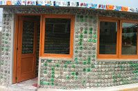 In #Metepec #Mexico has built a #school with #PETbottles and #stopers. To build the module used PET bottles filled with soil as bricks. The walls were formed bottles distributed in rows, while the base of the bottles forming the outer wall of the construction.The floor is formed with stoppers. The lids were placed on a mortar base, spaces filled with cement and sand. This structure keeps air inside, which serves by way of thermal and acoustic insulation.