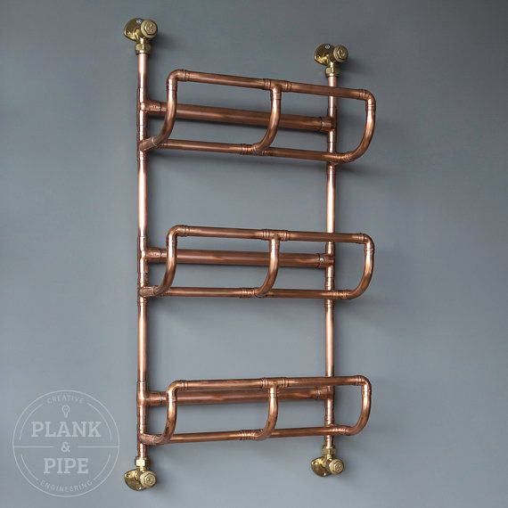 COPPER TOWEL RACK: 3 Tier - In a Natural or Polished & Lacquered finish.   This handmade Towel Rack is made using 15mm & 22mm copper pipe. Each copper joint is professionally soldered making it a strong and one solid piece. The pictures show the copper in a Polished & Lacquered finish that will maintain its bright, reflective shine. A natural finish will arrive to you with the same appearance and will then darken over time to a warm, deep brown industrial colour. You can see examp...
