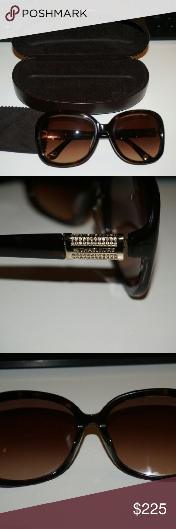 Michael Kors Sunglasses Gorgeous Michael Kors Sunglasses. Tortoise color.  Like new. Excellent Condition. Gold logo on the sides with rinestones that shine. These glasses will make a statement to any outfit!  Prefect for those sunny days! Michael Kors Accessories Sunglasses