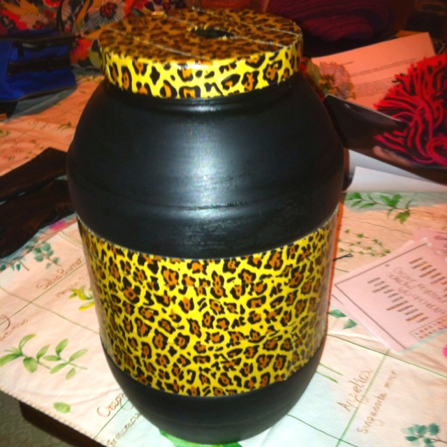 Homemade piggy bank made out of an old party mix jug, black paint, and cheetah print duct tape from 5below :)