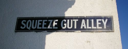 Squeeze Gut Alley is one of the many alley ways which make up a large section of Whitstable, on the south east coast of England. First designed to provide easier access to the sea, smugglers and tourists alike have used them to navigate through the town.
