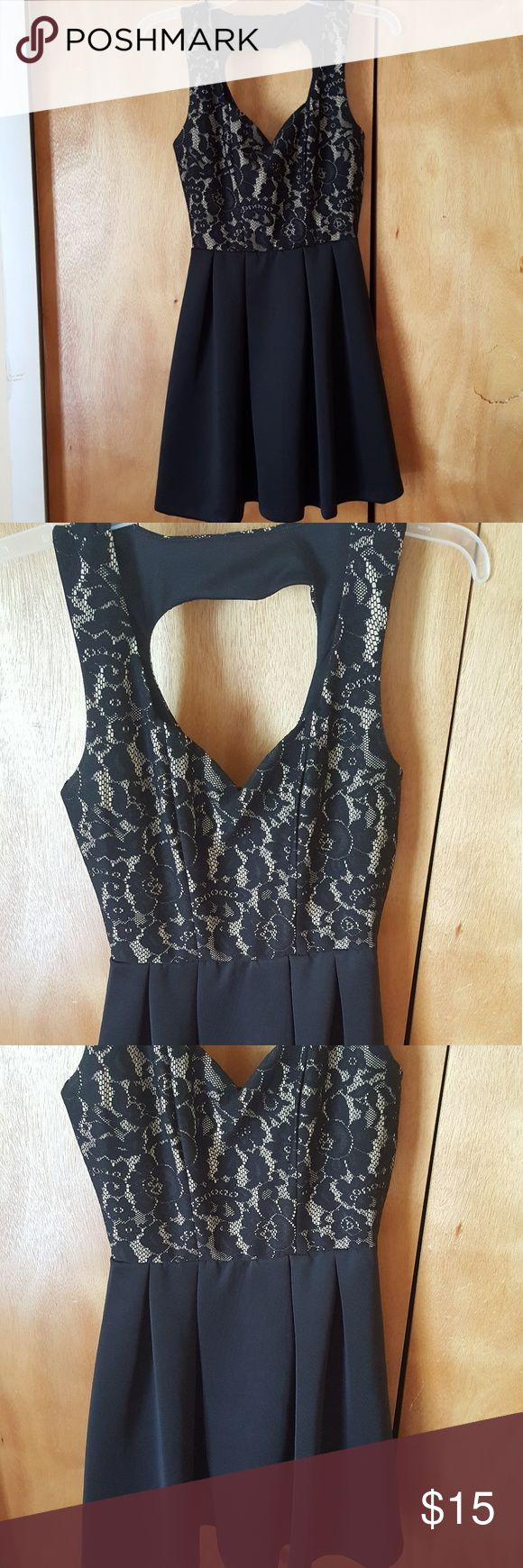 Beautiful dress only wore once. Heart shaped in front and back of dress. Great condition almost like new. Top part has lace... Self 92% polyester 8% spandex. Contrast and lining 100% polyester. Body Central Dresses