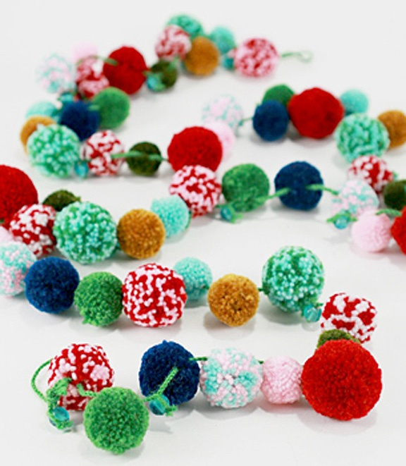 yarn pom pom garlands: for Christmas, use white and red for popcorn and cranberries