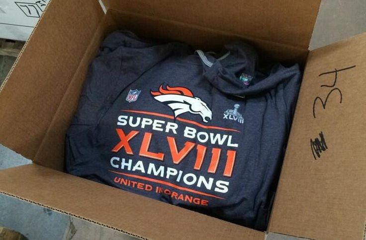 Denver Broncos Super Bowl champion gear is packed up by a relief organization to be donated to folks in Africa