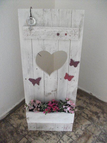 window box on a shutter with heart cutout and butterflies