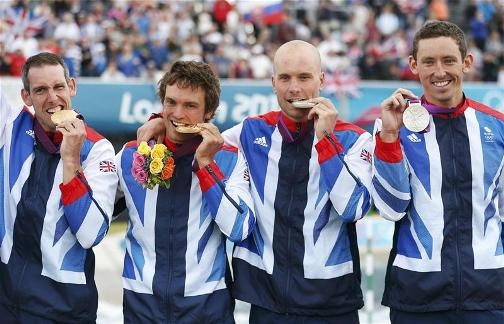 PICTURE PERFECT: Team GB's silver medallists David Florence and Richard Hounslow join compatriots and gold medal winners Tim Baillie and Etienne Stott in celebrating their men's canoe double success