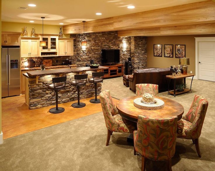Architecture:Good Basement Finishing Ideas With Coffee Table Sets On Rugs Feat Unique Kitchen Bar And Bar Stools Plus Stainless Steel Refrigerator And Kitchen Cabinets Denver Pendant Lighting With Brown Sofas Flat Screen Tv Speaker The Coolest Basement Finishing Ideas for Your On – going Remodeling Basement