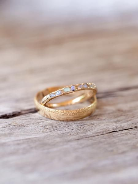 Opal Fossil Ring in Gold // Hidden Gems    Each tiny one of these rough gems has its own complex rainbow array of colors.