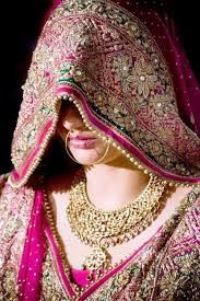 Rajasthan is a place where culture and values play a lot of role. You would find brides covering their face with veils in front of their elders. Their bridal dresses feature heavy work on the veils, which are mixed and matched with traditional jewelry.