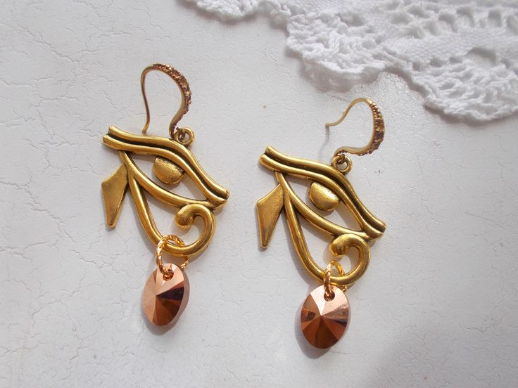 Egyptian Eye of Rah with Swarovski rose gold x 2 tears, drop dangle earrings by RicePaperJewels on Etsy