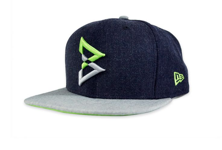 """Marshawn Lynch """"Beast Mode"""" New Era 9FIFTY Navy & Green Snapback. Worn during the Superbowl 2015 Media Day, this hat is here just so it is not fined."""