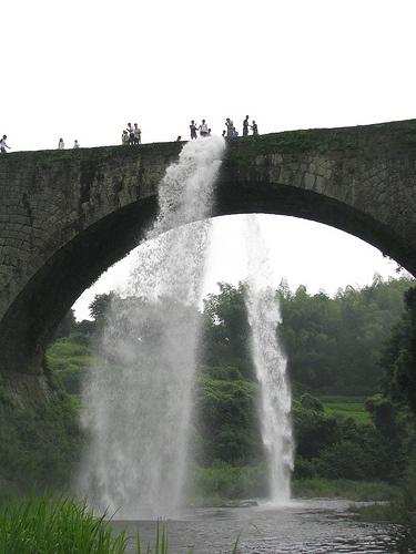 I love this - the arch and water look like an umbrella! The water bridge in Tsujyun, Japan , Kumamoto