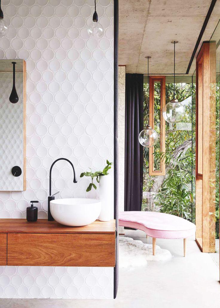 Bathroom with textured wall, big windows and bulb lights