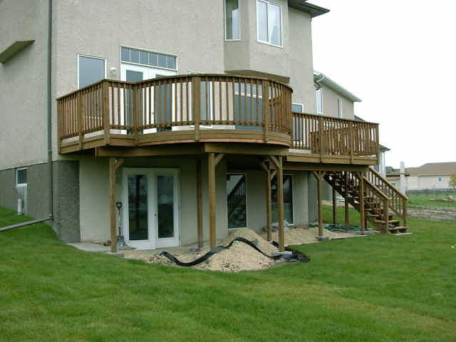 Multi level wooden deck with walkout basement design ideas for Walkout basement designs