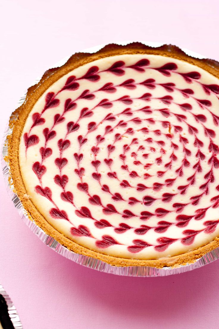 Pre-baking... Is there a more indulgent, decadent, comfort food that cheesecake? Yes! White Chocolate Raspberry Cheesecake =). You would never believe this