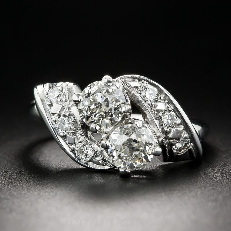 a charming vintage toi et moi ring starring a precious pair of bright white old