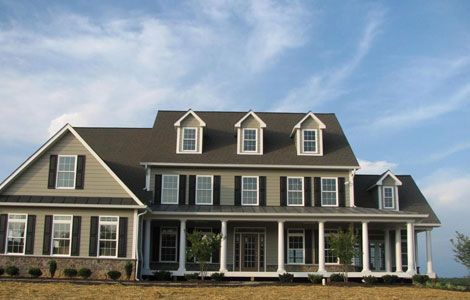 Tan house with black shutters browse our siding trim for Tan siding shutter color combinations