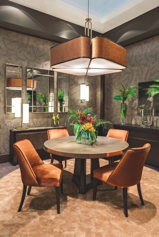 The Autumn Leaves room by Oasis features a special edition of the Murat table, with a bronzed top. The table is completed with chairs Musa, with a velvet orange cover. The furnishings includes also the Moritz cupboard, the Khan console and the wall is decorated with the Cocteau mirror.  The lighting is given special attention, thanks to the big suspension lamp, Quadrifoglio, perfect for dining room, the Flower floor and wall lamps, and the Edge floor and table lamps, with an Art Déco flair.