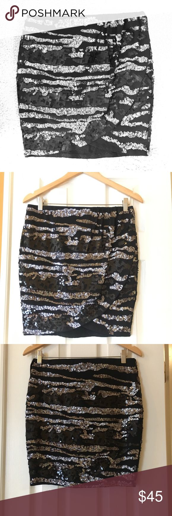 Express Sequin Mini Skirt Black and silver sequin mini skirt with slip and elastic waistband. Perfect for a night out!   ✔️ Excellent Condition   🚭 Smoke free   📦 Will ship within 1-2 business days. Express Skirts Mini