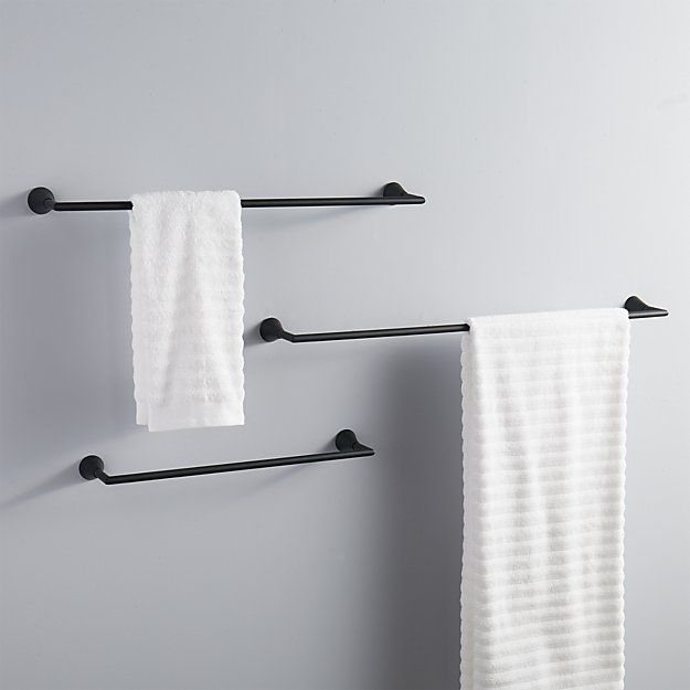 Shop black towel bars.   Clean straightforward silhouette in modern matte black elevates towels with chic sophistication.  Pair with black wall hook to complete the look.