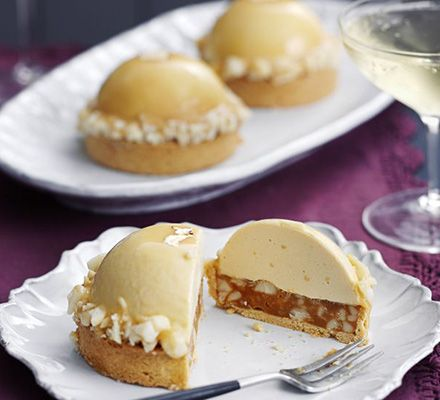 Edd Kimber's Caramelised white chocolate, ginger caramel & macadamia tarts. This stunning patisserie-standard, mousse-like dessert from Great British Bake Off winner Edd Kimber is pure indulgence on a plate