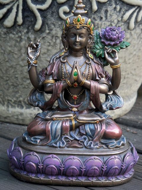 """One of the deities most frequently seen on altars in China's temples is Quan Yin (also spelled Kwan Yin). In Sanskrit, her name is Padma-pâni, or """"Born of the Lotus."""""""