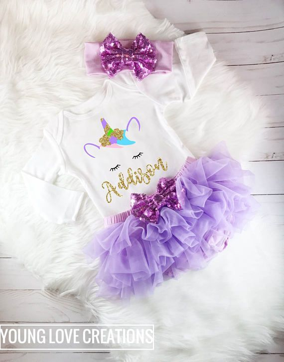 How adorable is this Personalized Unicorn Outfit in purple Coming Home from the hospital Newborn Outfit, Baby Shower Gift or birthday outfit!  This listing includes any of the following: ***Long Sleeve Bodysuit Only ***Short Sleeve Bodysuit Only ***SS (short sleeve) bodysuit + bow ***LS (long sleeve) bodysuit + bow ***Long Sleeve Bodysuit + bloomer ***Short Sleeve Bodysuit + bloomer ***SS Entire Outfit (SS bodysuit + bow + ruffle bloomers) ***LS Entire Outfit (LS bodysuit + bow + ruffle…