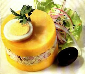 When I was in Peru, this was my favorite meal other than alpaca :) It is called Causa Rellena. It is yellow mashed potatoes filled with tuna and avocado.