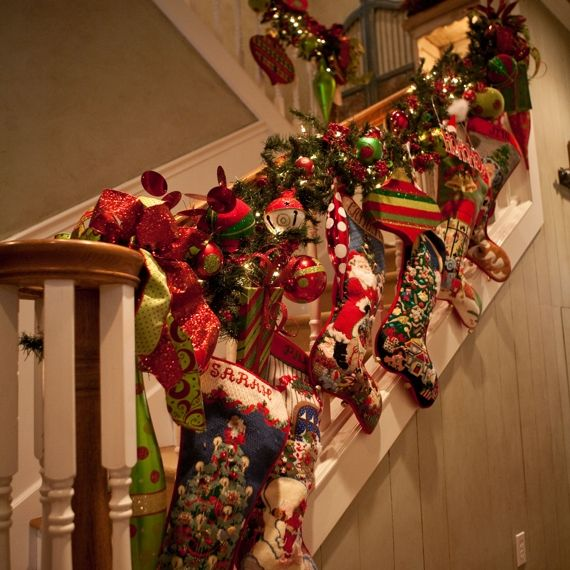 Stockings garland cute idea to hang stockings on for Stair railing decorated for christmas