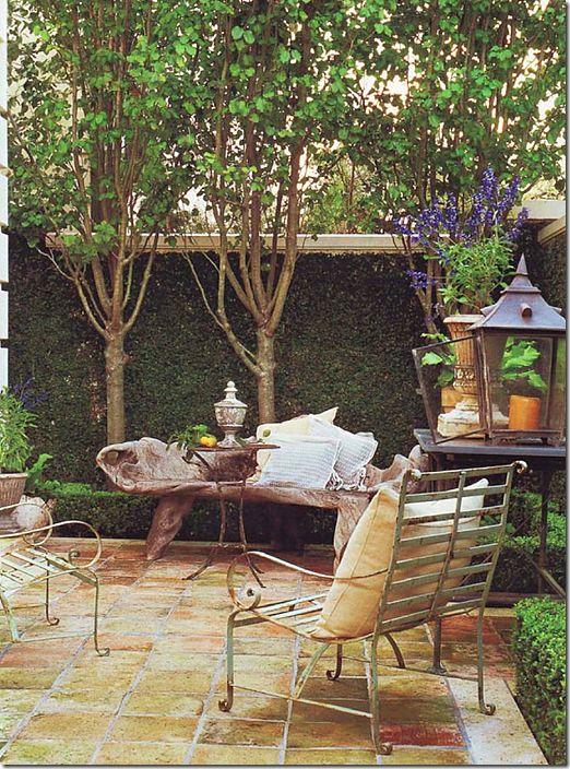 Veranda Magazine's beautiful courtyard with pillows and lanterns.