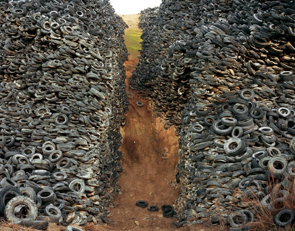 What to do with this mountains of old car tires?   We use them to manufacture our great Rubber Speed cushions!  The recycled portion of rubber in our speed cushions is made of old car tires which helps to reduce the amount of waste found in tyre dumps around the world and is used for the main structure of the speed cushions.The top layer of our rubber speed cushions is made from high quality pure rubber which improves traction and wet weather performance.