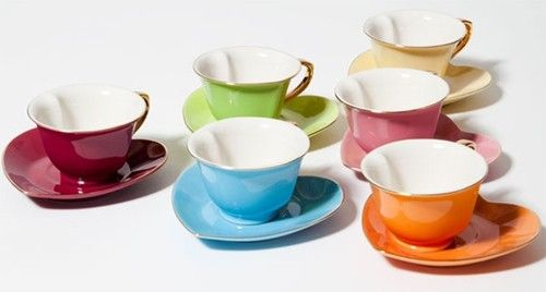 Set of 6 Inside Out Heart Cups & Saucers: This pretty and stylish set comes in an array of yummy sounding colors, including pumpkin orange, banana yellow, cranberry red, lime green, turquoise blue and bubblegum pink. Gold hued trim lines the tops of the mugs, the outside of the saucers, and the handles.